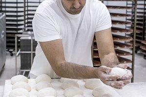 Baker kneading bread