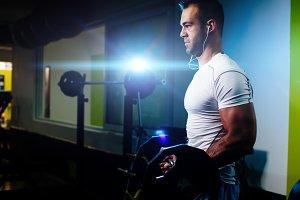 bodybuilder pumping up hands