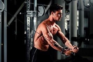 handsome bodybuilder pumping up arms