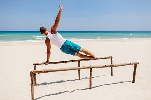 fitness man work out on the beach