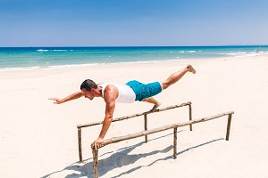 fitness man workout sport on beach