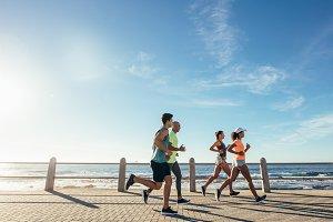 Group running along a seaside
