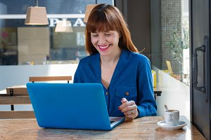 Woman smiles at the laptop