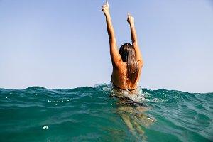 sexy woman swim in sea waves