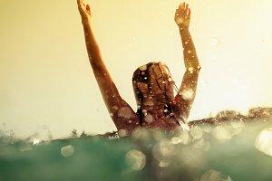 sexy woman swim sea waves splash