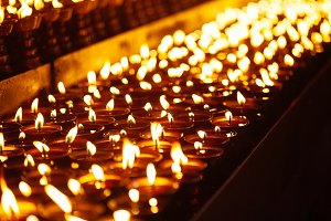 candle flames glowing in the dark