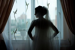 A silhouette of a bride