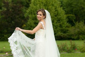 Bride spreads her veil