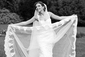 Pretty bride spreads her veil