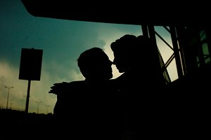 A kiss of newlyweds silhouettes