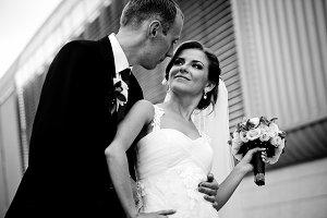Groom looks in bride's eyes