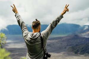 Man with a camera on the volcano
