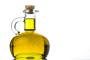 Olive oil in rustic jar isolated