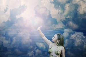 Fantastic girl in the blue sky