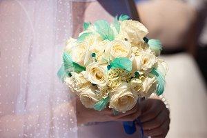 Bride holds reach wedding bouquet