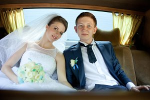 Bride and groom on the back seat