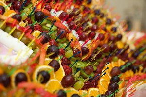 Exotic fruits pinned with sticks