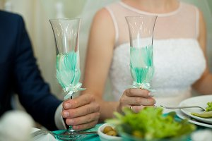 Bride and groom hold champagne