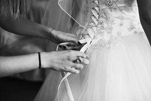 A lady's hands lacing bride's corset