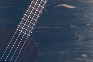 Ukulele on a dark wooden background