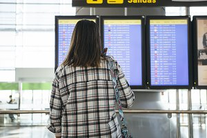 Woman checks her flight
