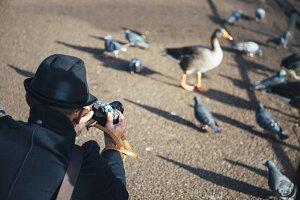 Man taking photo at St James Park