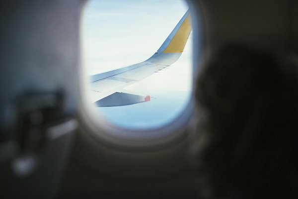 Airplane Window View High Quality Holiday Stock Photos