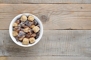 Brown sugar in bowl on wooden table
