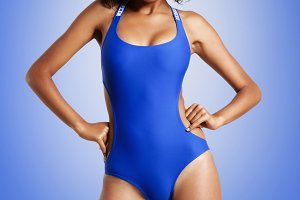 mixed race woman in blue swimsuit