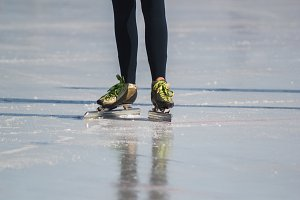 Ice skates, winter sport - green colourful boots