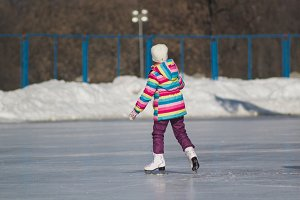 Winter sport - little girl on ice-rink - children's skating