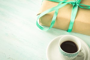 Coffee and wrapped gift box