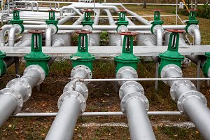 steel pipes and green valves