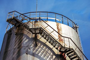 Large oil tank in industrial plant