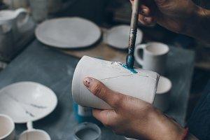 Woman painting a mug