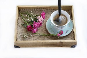 Wooden tray with teacup
