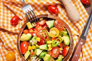 Avocado, corn, tomato salad