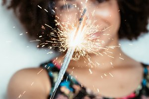 Young woman with sparkler