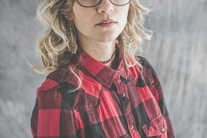 Natural girl with glasses on neutral background