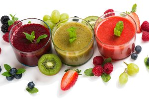 Assortment of smoothies and fruits