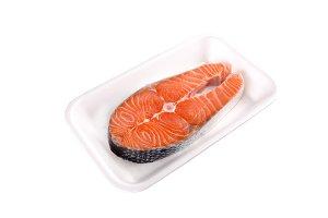 Raw salmon steak in tray