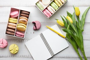 Feminine workspace with macarons and tulips