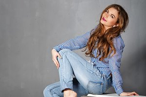 Girl in jeans and a striped shirt