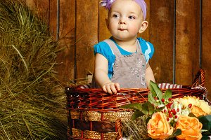 Little girl sitting basket