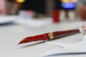 Red paint brush artist