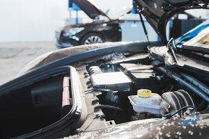 Automobile garage - hood of luxury sport car