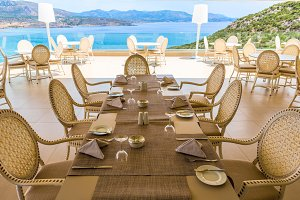 servered table in restaurant on the sea