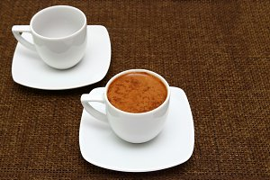 Two cups with greek coffee on a sacking