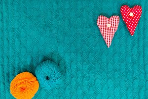 valentine green knitted background with hearts
