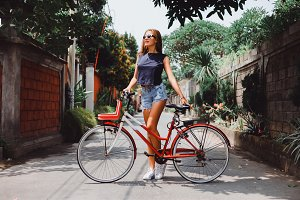 Woman posing with bicycle
